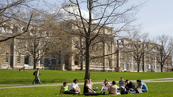 students outside Sibley Hall in the spring
