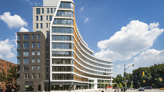 modern curved building in an urban setting
