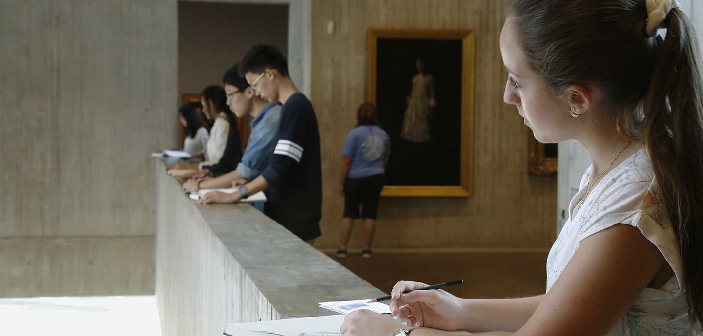 Students drawing at the Herbert F. Johnson Museum of Art.