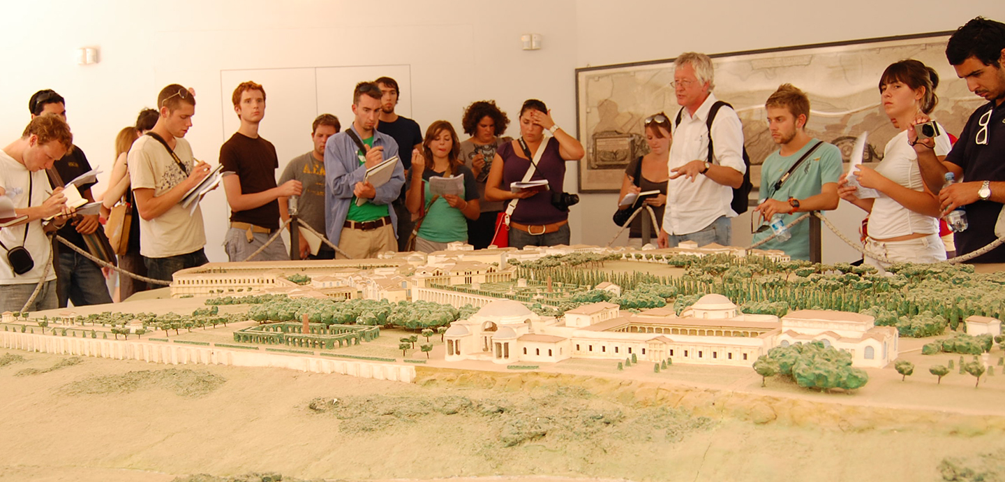 Students and instructors view a 3D map of an ancient Italian city.