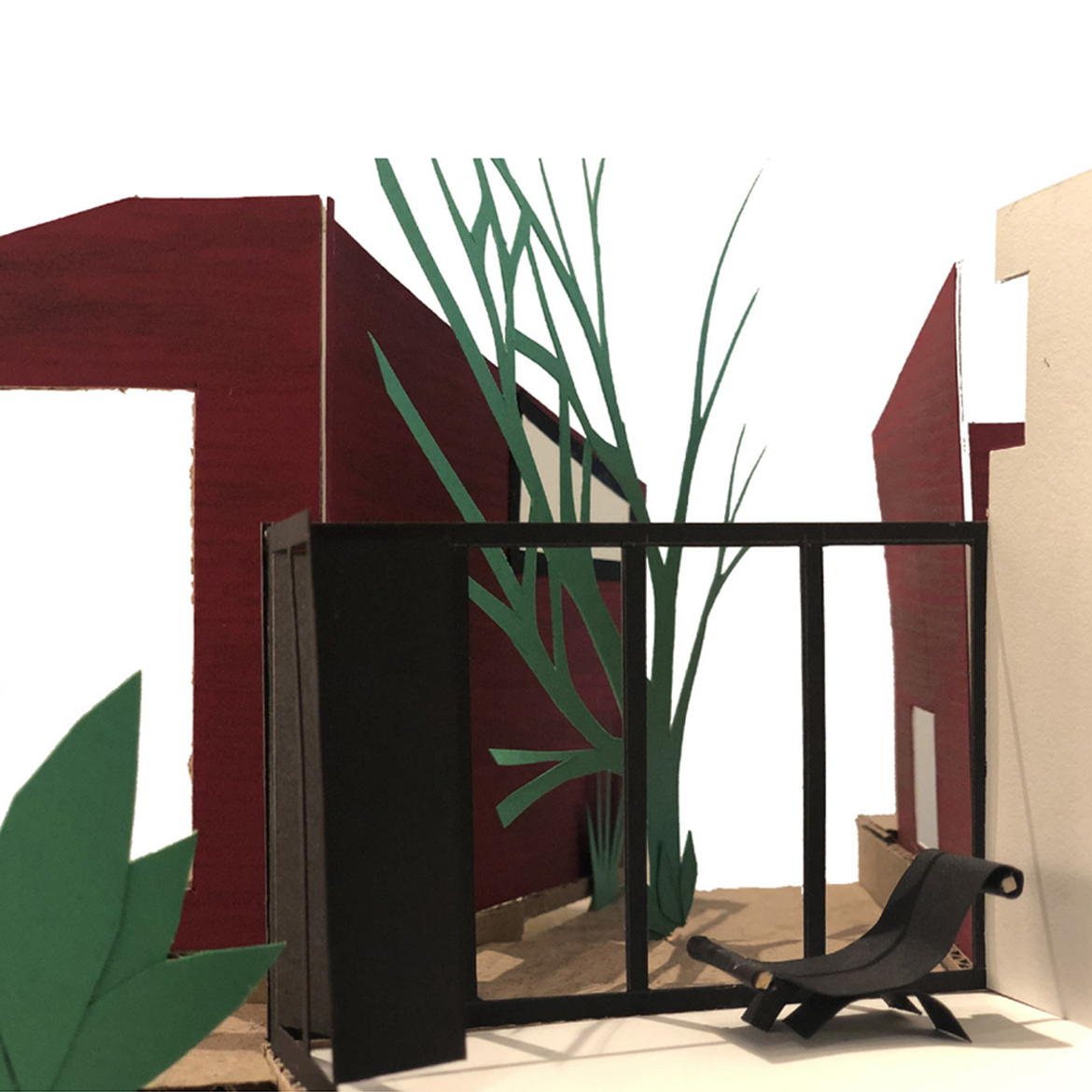 Colored cardboard cutouts showing a building with plants and a chair.