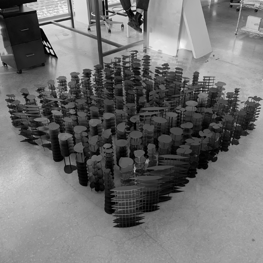 A collection of architectural sculptures sitting on the ground in a group formation.