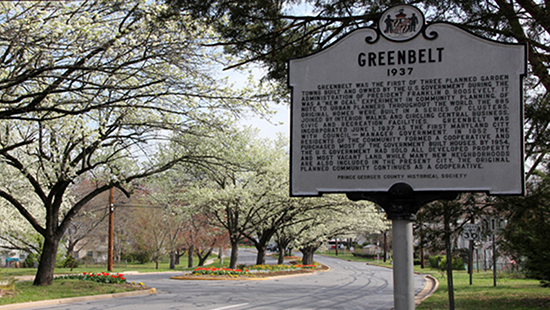 sign for Greenbelt, Maryland, with text describing the historic town