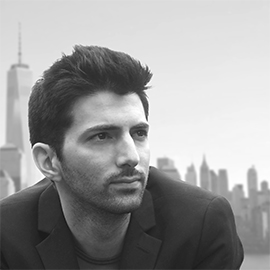 black and white headshot of a young man with dark hair and New York City behind him
