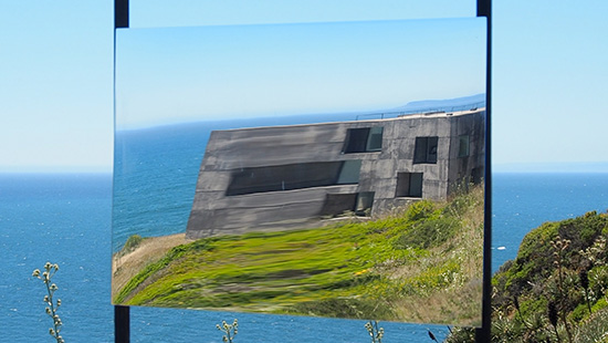composite photo of ocean landscape and distorted house on a bluff