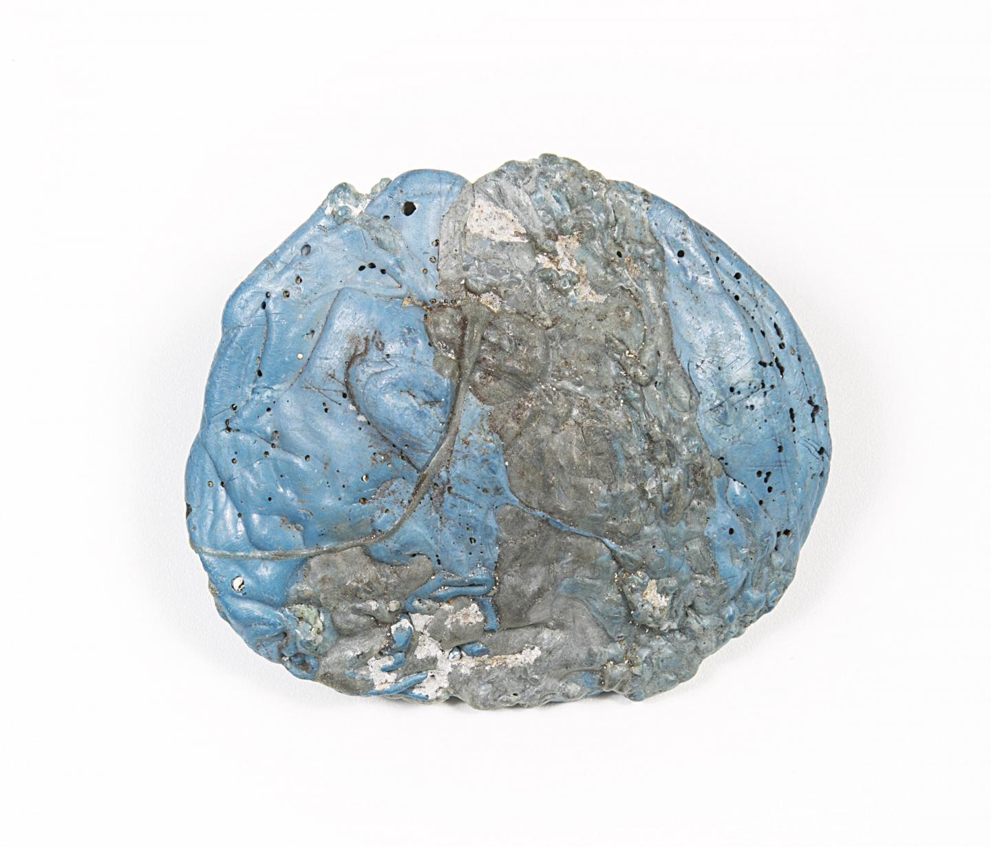 Spherical lump of blue material infused with grey metal.