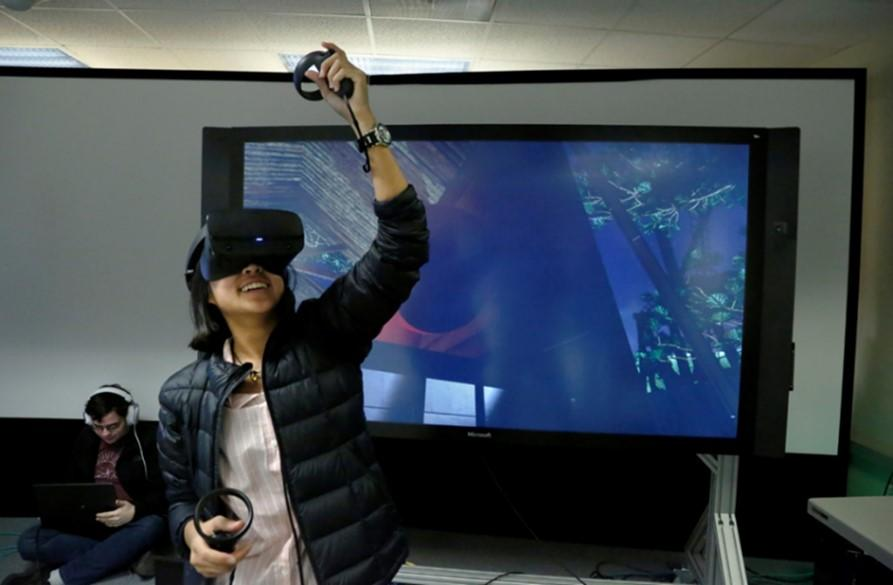 A young person wearing virtual reality googles.