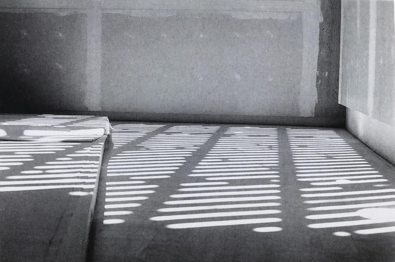 uneven floor tiles seen in a corner at very close range