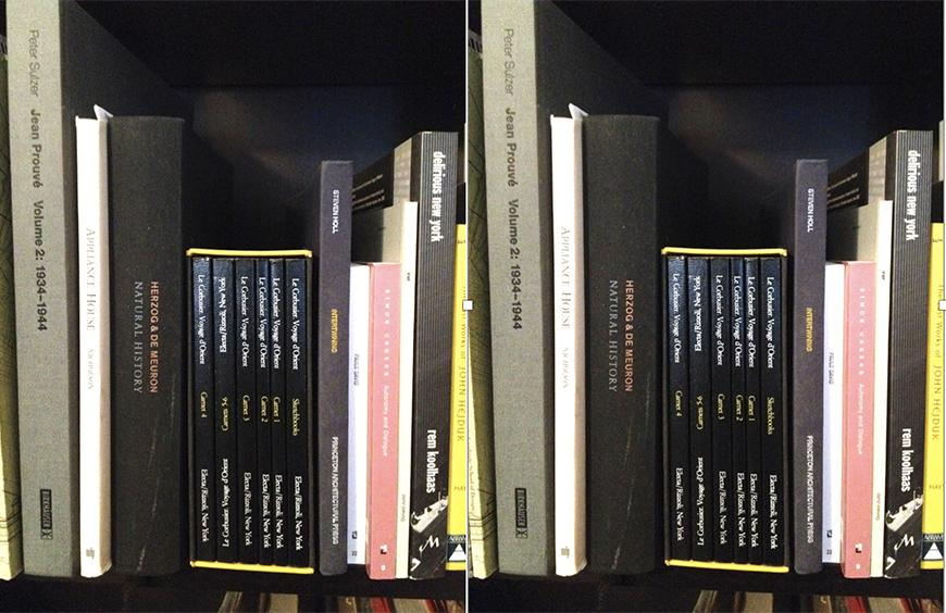 A series of architecture text books on a shelf