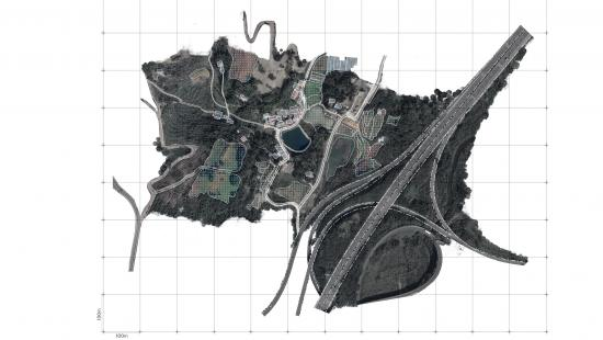Irregular shapes of builtup land, open spaces, grids, and roads seen from above