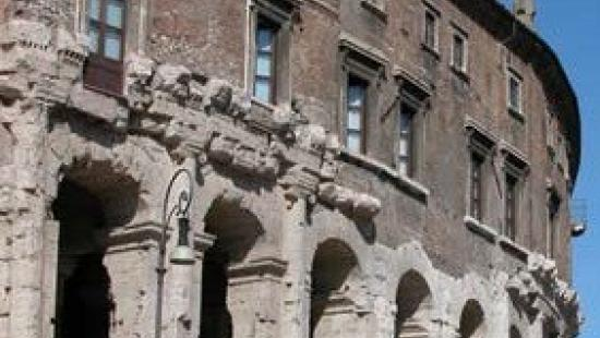 a curved and colonnaded facade of an ancient building
