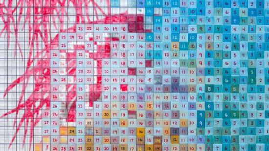 an array of squares with numbers on them in varying colors creating an overall art piece.
