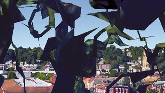 view of a city through leaves of a tree