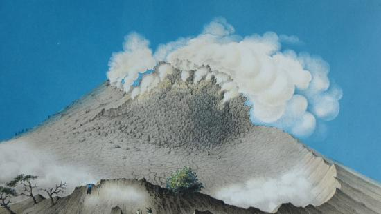the top of a volcano spews ash, two figures below point near dead trees, against a blue sky