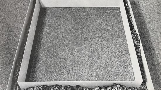 A white square set within a larger white square separated by rocks