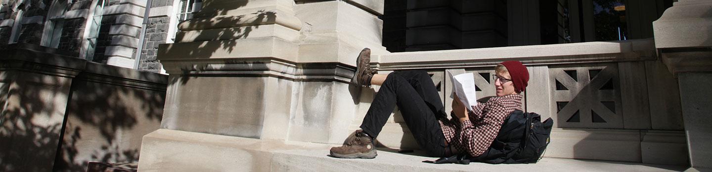 Andrew Jungkuntz (B.S. URS '14) relaxing in front of Sibley Hall