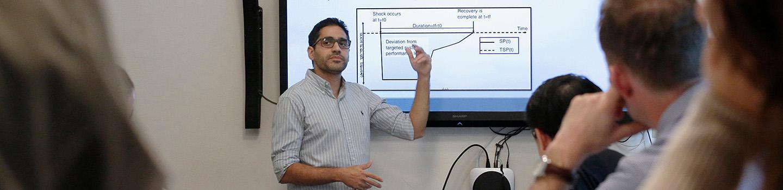 man pointing at LCD screen