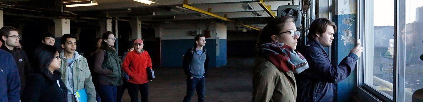 students tour an abandoned factory