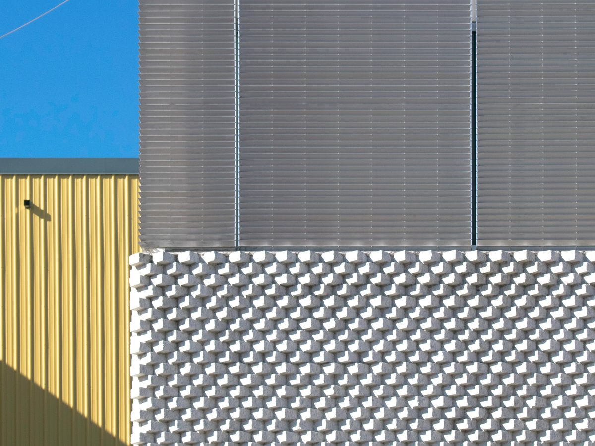 image of a grey and yellow building facade