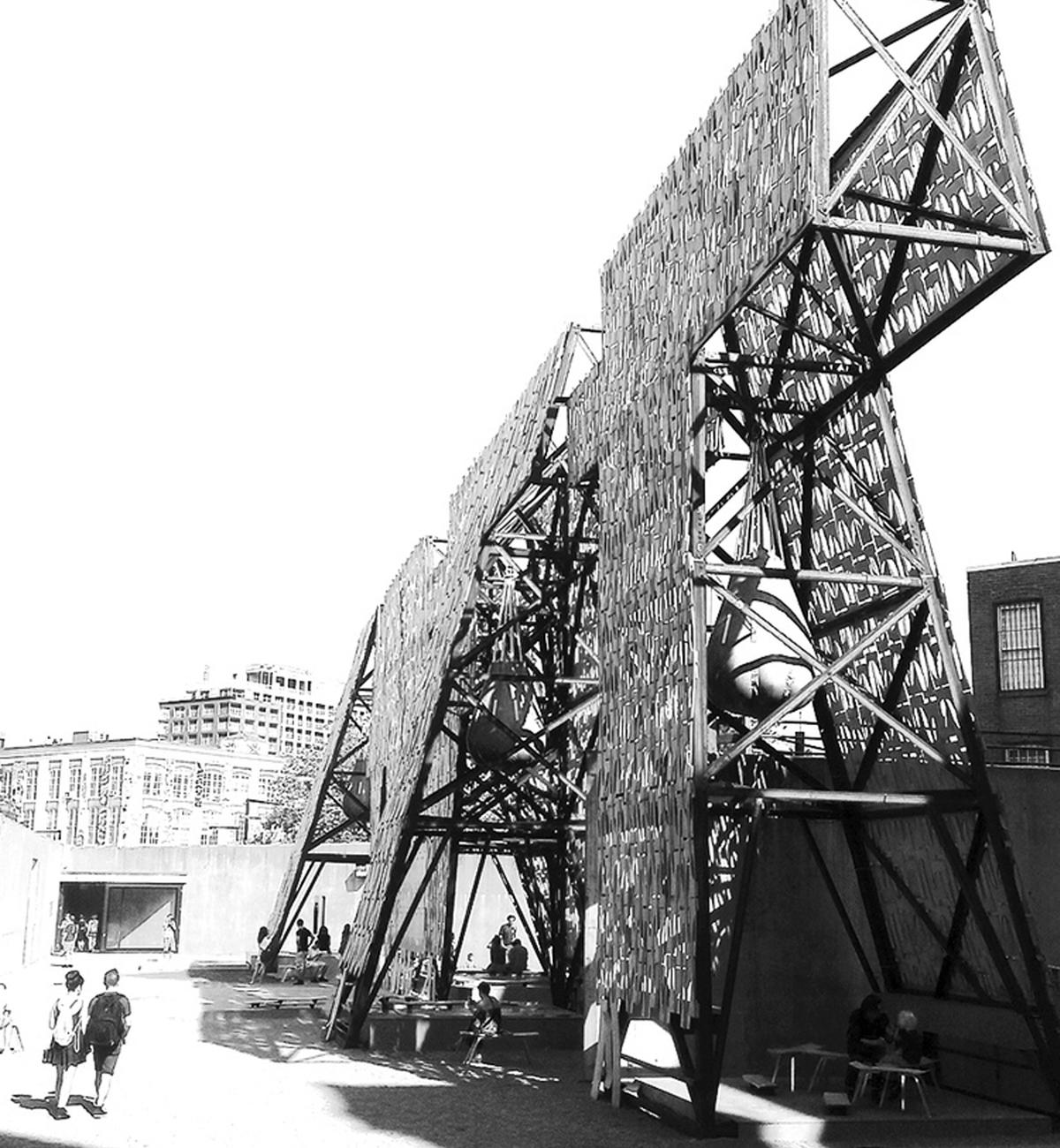 A bridge like metal structure with two people walking side by side.