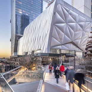 Rendering of silver curved building suspended over the High Line.