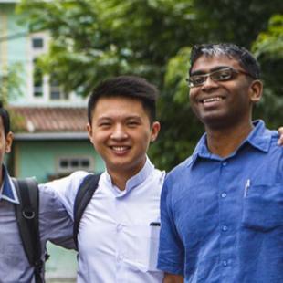 three men in blue shirts