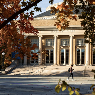 A building with columns viewed through fall trees