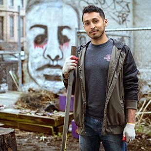 Alec Martinez standing in a derelict lot in harlem, ny