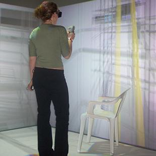 Two people using virtual reality technology in a room