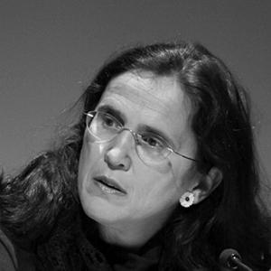 black and white photo of woman with long hair and glasses