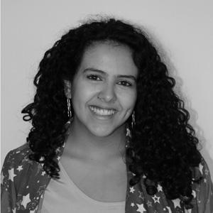 black and white photo of a woman with dark curly hair
