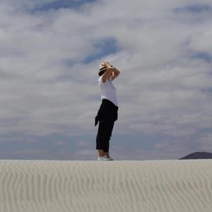 photo of a person from very far away in the desert
