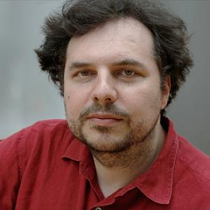 Headshot of Aleksandr Mergold