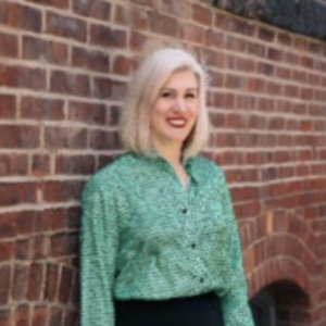 woman with light hair and green shirt