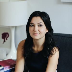 woman with dark hair, dark sleeveless shirt