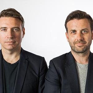 two men against a white background