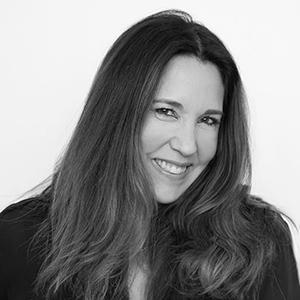 black and white headshot of a woman with long brown hair