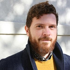 Headshot of a man with a red beard
