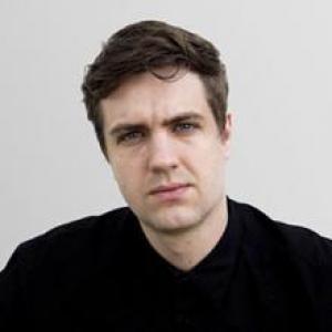 headshot of man against white background