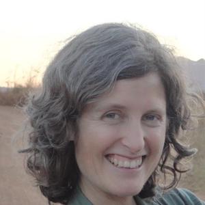 headshot of woman in desert background