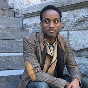 A man sitting on stone steps