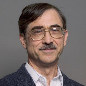 headshot of a man in glasses
