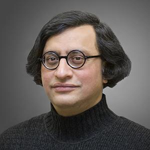 man with black hair and glasses