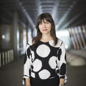 woman in a black and white polka dot shirt