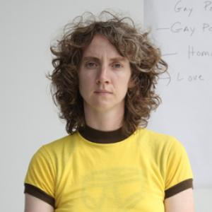 Woman with curly hair in a yellow T-shirt