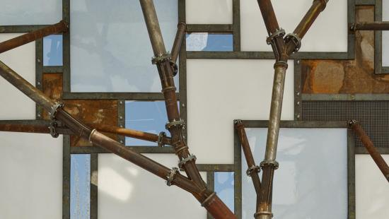Rusty metal pipes in front of blue and white glass panes.