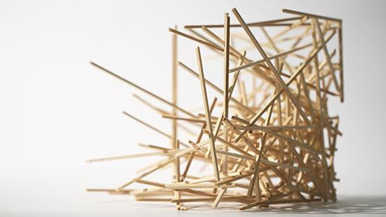 model created of many small light blond wooden sticks