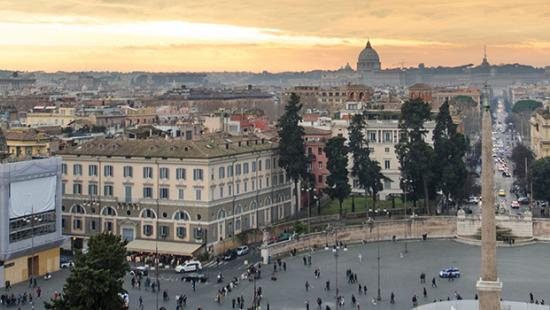 panoramic view of Rome with orange and yellow-toned sky
