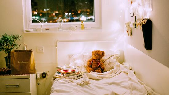 child's bed with teddy bear