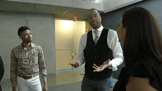 students and alumni conversing